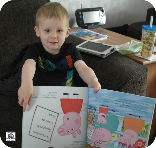 Child reading pepper pig book