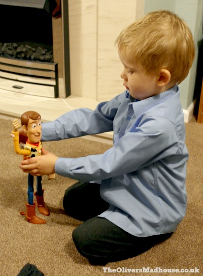 playing with toy story bull riding woody