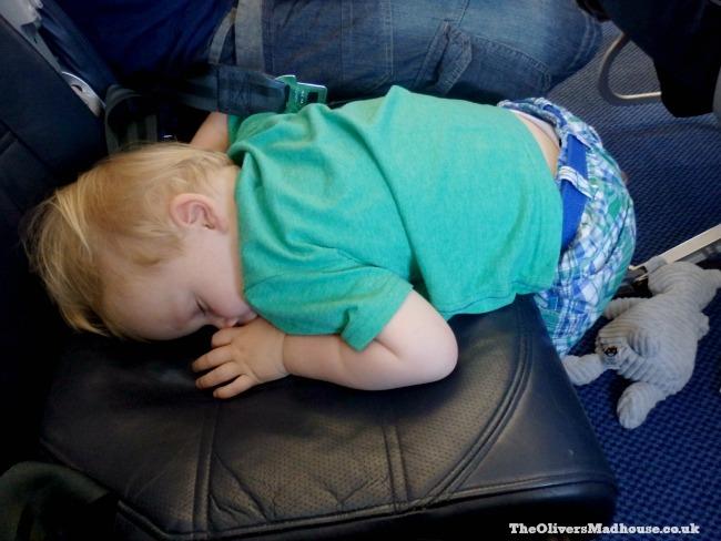 child sleeping on a plane