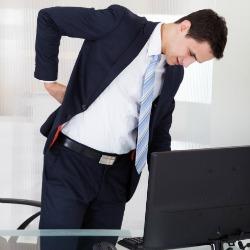 Backache-at-desk-e1460667472679