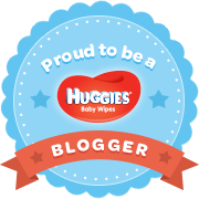 Round blue badge announcing 'proud to be a buggies wipes blogger'