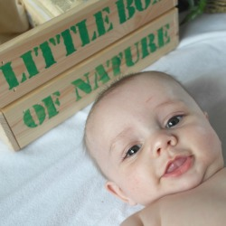 babys face with box that says little box of nature