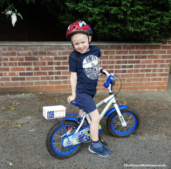 small boy showing off his bike
