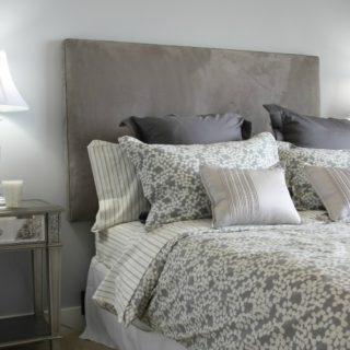 Luxury master bedroom done in grey.