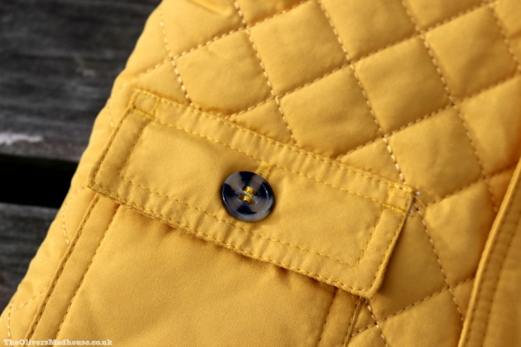 quilted detailing on nutmeg yellow coat