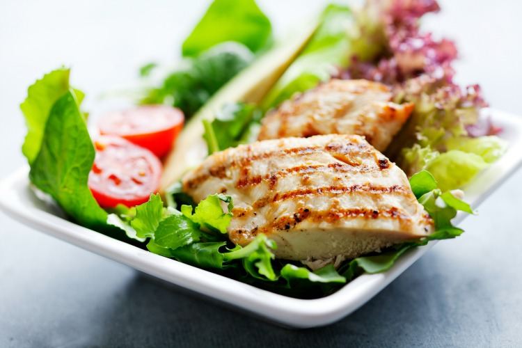 closeup of healthy salad with grilled chicken fillet, selection of