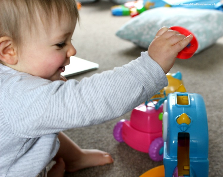 baby playing with fisher price hungry monster maze