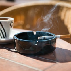 burning cigarette in the ashtray