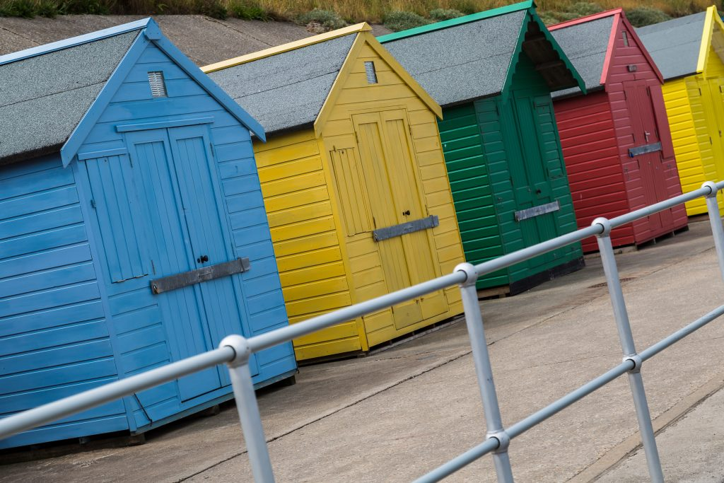 A slanted shot (partly to rid of distractions & partly to add a modern twist to a classical subject) of a row of beach huts which line the sea wall at Sheringham, Norfolk.