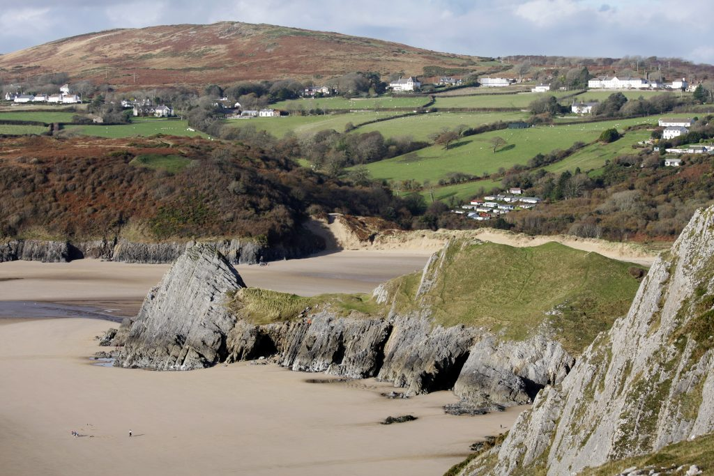 Welsh beach and cliffs from a high viewpoint.Three Cliffs Bay, Gower peninsula, Swansea