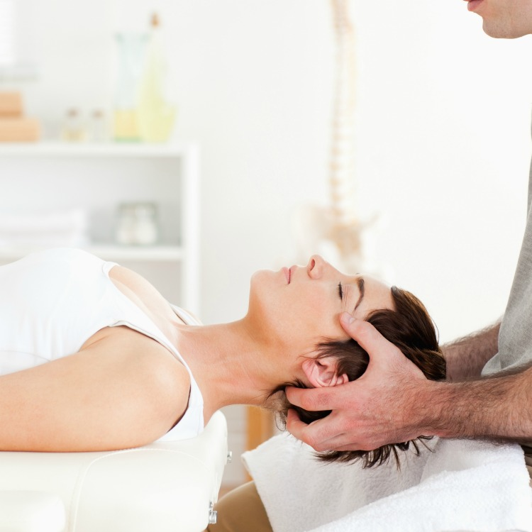 Chiropractor stretching a woman in a room